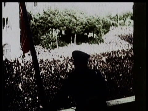 / benito mussolini delivers a speech from a balcony to an enormous crowd / mussolini rides in a convertible in a motorcade through rome / huge crowds... - benito mussolini stock videos & royalty-free footage