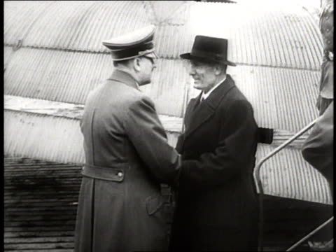 benito mussolini exits an airplane and shakes hands with adolf hitler, after which he greets and kisses the italian minister of foreign affairs,... - benito mussolini stock videos & royalty-free footage