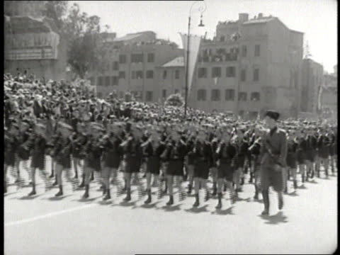 benito mussolini smiles as young boys in uniform march in a parade - benito mussolini stock videos & royalty-free footage