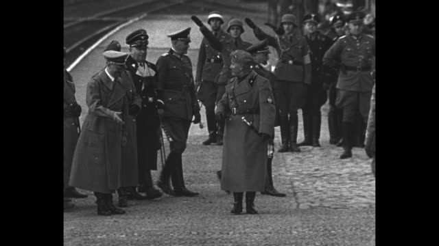 benito mussolini walking with german dictator adolf hitler and other german officers / mussolini and hitler walking along together / explosion going... - hermann goering stock videos & royalty-free footage