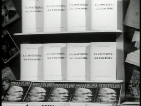 benito mussolini's 'doctrine of fascism' books on display. la dottrina del fascismo' title on cover. fascism. - benito mussolini stock videos & royalty-free footage