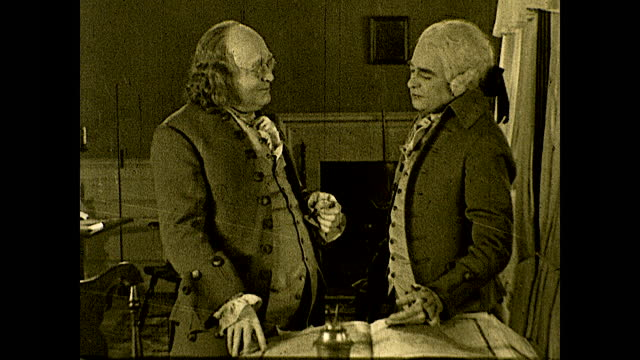 """benjamin franklin and john adams looking at map on the table and discussing possible french aid: """"yes, france! but she will help only when she sees... - benjamin franklin stock videos & royalty-free footage"""