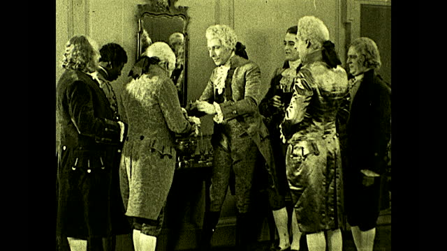 benjamin franklin and john adams meeting richard henry lee at party; lee surrounded by people and drinking. historical reenactment of early american... - benjamin franklin stock videos & royalty-free footage