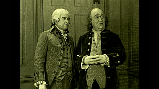 """benjamin franklin and john adams talking to each other about other guests at a dance: """"your cousin, samuel, would be more at home arguing politics in... - benjamin franklin stock videos & royalty-free footage"""