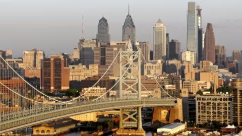 aerial benjamin franklin bridge and the city of philadelphia - philadelphia pennsylvania stock videos & royalty-free footage