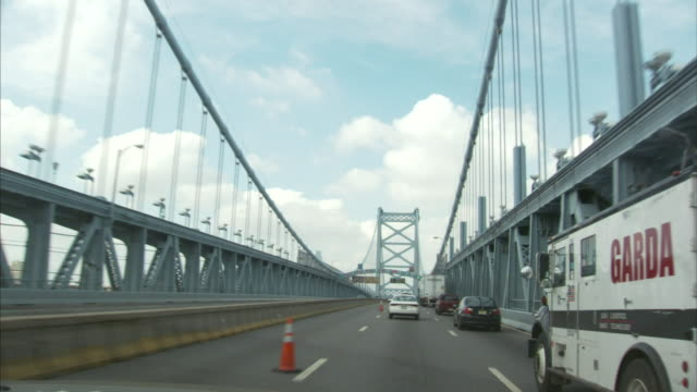 benjamin franklin bridge railings steel girder cables cars trucks driving orange traffic cones in left lane suspension - suspension bridge stock videos & royalty-free footage
