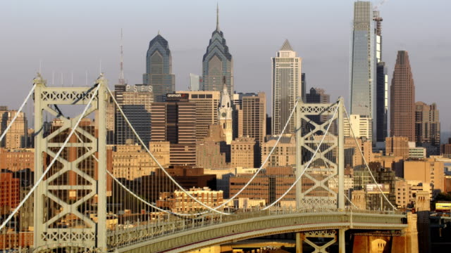 aerial benjamin franklin bridge with center city, philadelphia in the background - philadelphia pennsylvania video stock e b–roll