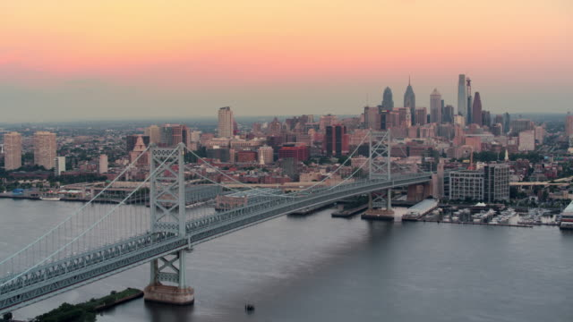 aerial benjamin franklin bridge with center city, philadelphia - center city philadelphia stock videos and b-roll footage