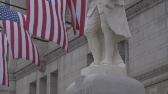 benjamin franklin statue and us flags in front of former old post office pavilion, washington dc, united states of america, north america - benjamin franklin stock videos & royalty-free footage