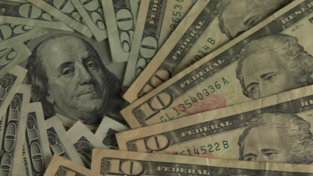 cu, pan, benjamin franklin's face surrounded with american dollar bills - benjamin franklin stock videos & royalty-free footage