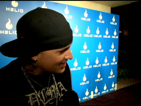 benji madden on looking forward to seeing the phone text messaging and taking photos at the helio launch event at private residence in los angeles... - text messaging video stock e b–roll