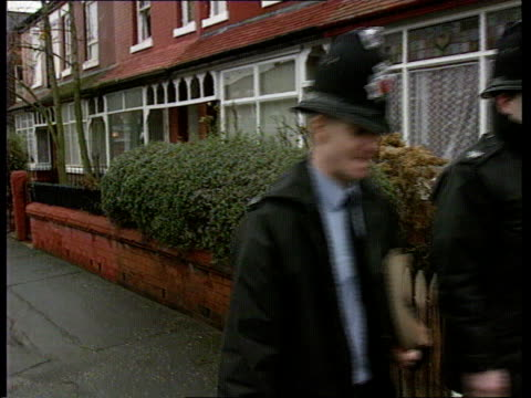 benji stanley murder ms two policemen walking towards pull out as past houses bv the two policemen up garden path as one knocks on front door of... - polyethylene stock videos and b-roll footage