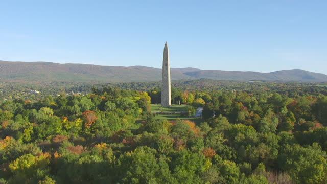 WS TU AERIAL POV Bennington Battle Monument with forest area / Bennington, Vermont, United States