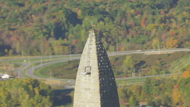 WS ZO AERIAL POV Bennington Battle Monument with forest area / Bennington, Vermont, United States