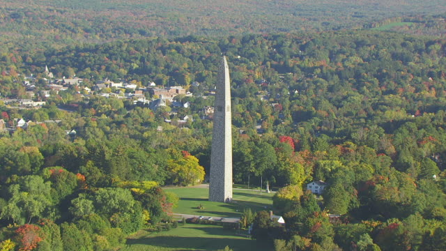 WS AERIAL POV Bennington Battle Monument with forest area / Bennington, Vermont, United States