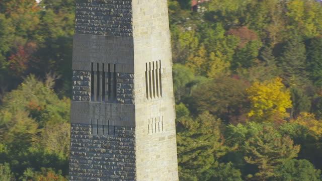 WS AERIAL POV Bennington Battle Monument with trees / Bennington, Vermont, United States