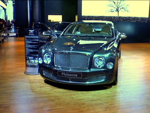 cu of bentley mulsanne info sign zi to xcu tilt up to ws bentley in background / ws from threequarter passenger side view / ws passenger side profile... - anamorphic stock videos and b-roll footage