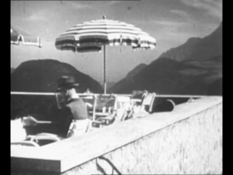 ws berchtesgaden area of bavarian alps with berghof adolf hitler's residence at center / rear shot hitler wears fedora hat as he sits on outdoor... - 1930 1939 stock videos & royalty-free footage