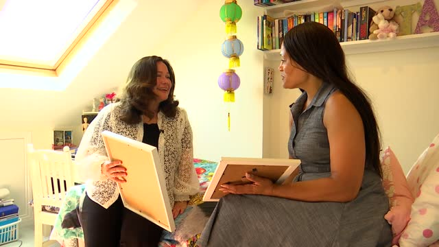 bereaved mothers call for 'allergy tsar'; england: int emma turay and tanya ednan-laperouse together on natasha's bed looking at framed pictures of... - tilt up stock videos & royalty-free footage