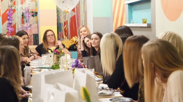 bereaved mothers set up group to cope with the loss of their children england london int various of women chatting as sat around table women hugging... - itv london tonight weekend点の映像素材/bロール