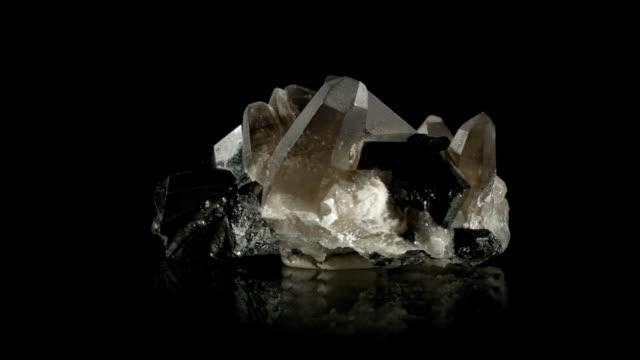 berg crystal rotating on black - quartz stock videos and b-roll footage