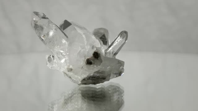 berg crystal rotating on white background - quartz stock videos and b-roll footage