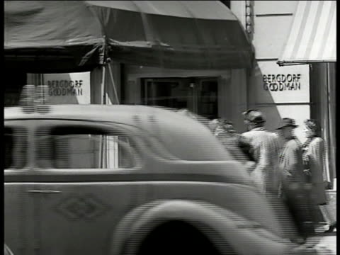 bergdorf goodman department store new yorkers 5th avenue nyc ws window shoppers elegant tube top stripe dress on mannequin cu woman looking at dress... - bergdorf goodman stock videos and b-roll footage