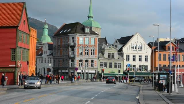 stockvideo's en b-roll-footage met bergen norway bryggen old town old buildings and area for tourists in bryggen area scenic color - kerk