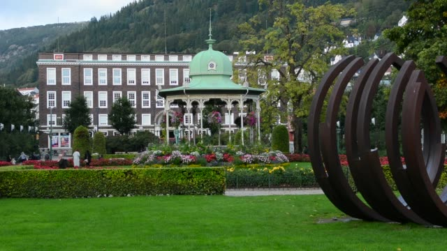 bergen norway music pavillion colorful gazebo with flowers in downtown with rikstelegraf and rikstelefon building in background - gazebo stock videos and b-roll footage