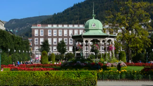 bergen norway music pavillion colorful gazebo with flowers in downtown with rikstelegraf and rikstelefon building in background and sculpture in front - gazebo stock videos & royalty-free footage