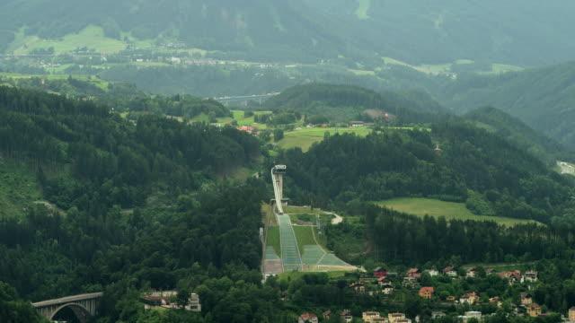 ls zi bergisel (mount isel) olympic ski jump; brenner tollway in far background - north tirol stock videos & royalty-free footage