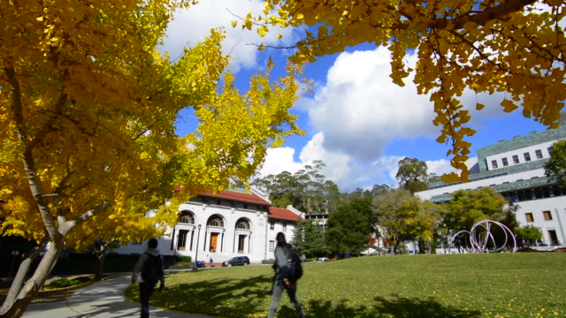 Berkeley California University of California at Berkeley, Hearst Memorial building with rings sculpture in front with fall leaves color