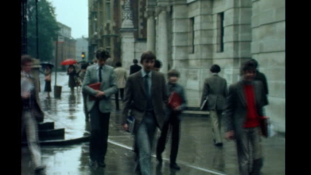 eton ext eton college building eton schoolboys along split screen eton college and pupils / various scenes in liverpool in 1977 - eton berkshire stock videos and b-roll footage