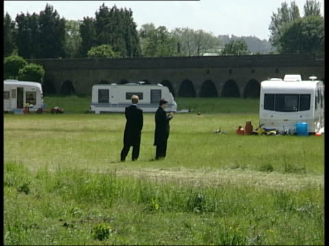 berkshire eton ext lms two eton pupils standing in playing fields surrounded by travellers' caravans bv eton schoolboys looking at caravan camp set... - eton berkshire stock videos and b-roll footage