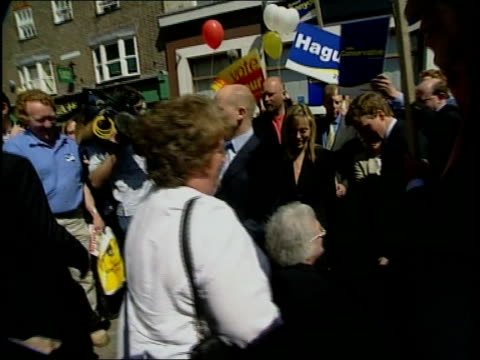 berkshire newbury william hague mp along with wife ffion hague as surrounded by press and tory supporters during general election campaign walkabout... - newbury england stock videos and b-roll footage