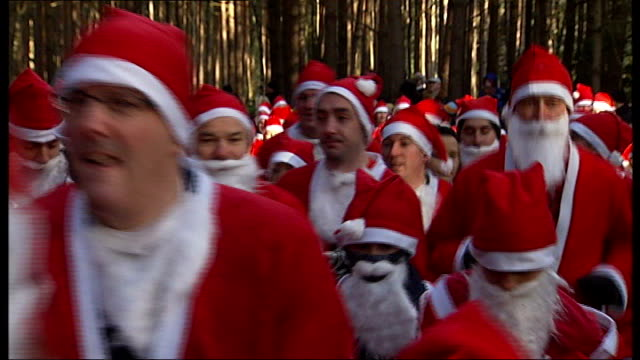 berkshire swinley forest ext runners setting out on santa dash charity run for thames hospicecare general views of santas running through woodland... - oliver phelps stock videos & royalty-free footage