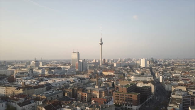 berlin aerial shot flying towards tv tower - schwenk stock-videos und b-roll-filmmaterial