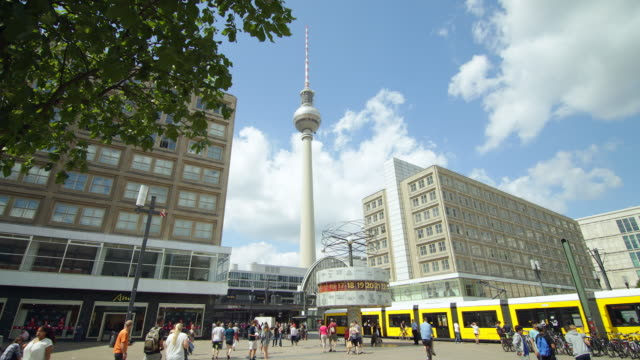 berlin alexanderplatz summer day with citylife and crossing train - alexanderplatz stock videos & royalty-free footage