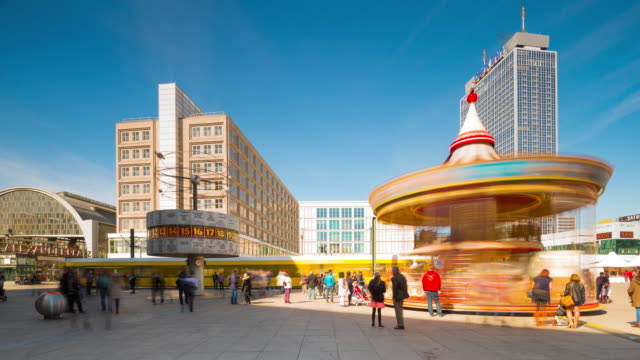 Berlin Alexanderplatz with Dynamic Carousel and World Time Clock and driving Train Timelapse
