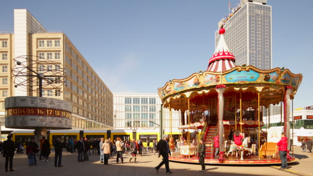 Berlin Alexanderplatz with Dynamic Carousel and World Time Clock and driving Train in Realtime