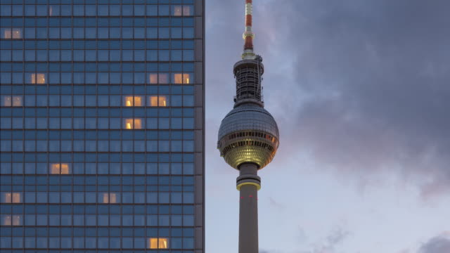 berlin city modern business building and tv tower timelapse zoom from day to night with sunset and beautiful cloud dynamic - famous place stock-videos und b-roll-filmmaterial