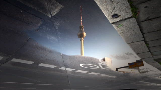 berlin city street reflection timelapse with tv tower and speeding cars - road marking stock videos & royalty-free footage
