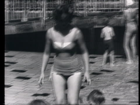 construction of the wall everyday life behind the wall everyday life in eastern berlin children playing w/ sand and at pool people at beach in... - 1961 stock-videos und b-roll-filmmaterial