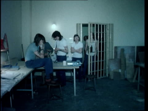 berlin drugs; east germany: west berlin: pidetosee prison: av painting on wall; tilt 2nd : wire on wall; pull out side of prison: youths in workroom:... - guest stock videos & royalty-free footage