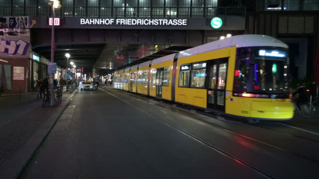 berlin friedrichstrasse urban nightlife street scene with traffic lights steady cam dolly shot - tracking shot stock videos & royalty-free footage
