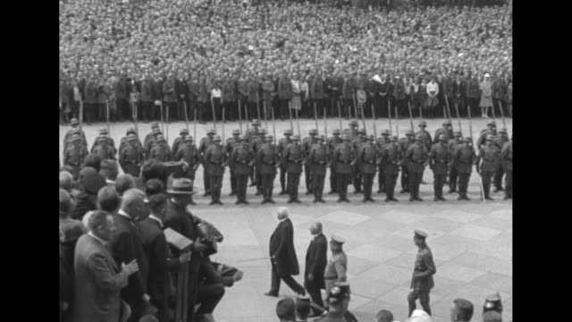 [berlin] german president paul von hindenburg walks down entry stairs at the reichstag building with a crowd of hundreds looking on / hindenburg... - präsident stock-videos und b-roll-filmmaterial