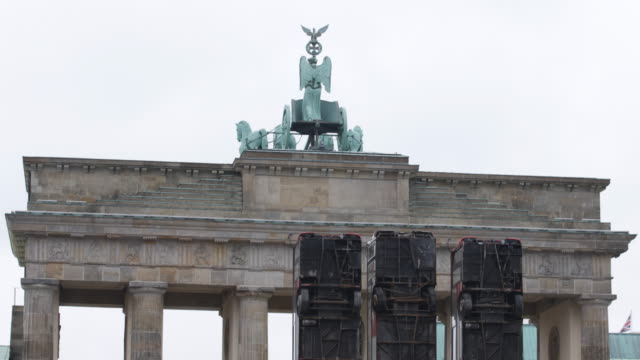 Close up and pan down from the Quadriga Brandenburg gate to the installation GermanSyrian artist Manaf Halbouni attends the installation of his work...