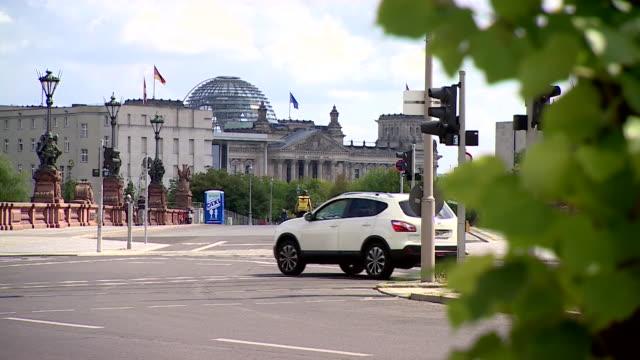 "berlin gvs with german flag evident - ""bbc news"" stock-videos und b-roll-filmmaterial"