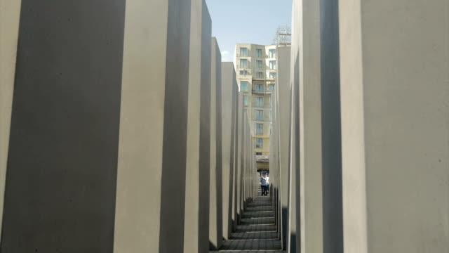 berlin, holocaust memorial, people walking through, memorial,ws, - one mid adult man only stock videos & royalty-free footage
