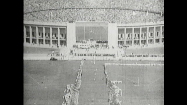 berlin olympic marathon on august 9 1936 in berlin 56 runners started the race at the signal gun spectators at the stadium observing the race the two... - 1936 stock-videos und b-roll-filmmaterial